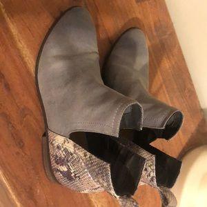 Grey flat bootie with snake skin heel